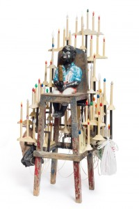 """Nick Cave, """"Golden Boy"""" (2014), mixed media including concrete garden ornament, vintage high chair, dildo, and holiday candles, 73 3/4 x 41 x 35 in (© Nick Cave) (photo by James Prinz Photography, courtesy the artist and Jack Shainman Gallery, New York)"""